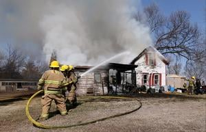 Fire fighters response to house fire near St. Libory