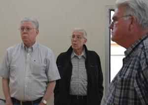 <p>From left, Lincoln City City Councilors Roger Sprague, Wes Ryan and Jim Davis listen to Lincoln City Building Inspector Brandon Zipser's analysis of the Elks Lodge, located at 2020 NE 22nd St. The city is considering buying the property, which officially closed its doors March 26.</p><p>Paul Christiansen/The News Guard</p>