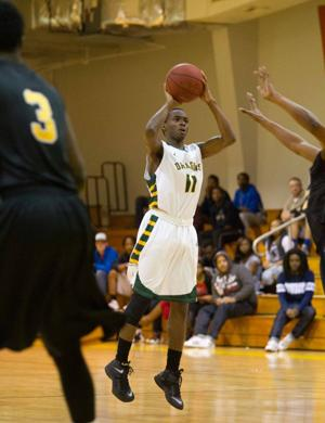 <p>Paris Junior College sophomore Brandon Scott puts up a 3-pointer during a game earlier this season. Scott had a game-high 27 points and seven 3's against Navarro.</p>
