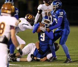 <p>Clarksville running back Zae Lewis (9) fights for extra yardage in the Tigers bi-district game last week. The Tigers fell to Bosqueville in the area round on Friday.</p>