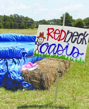 Turning a few hay bales and a tarp into a summer oasis for Hay bail pool