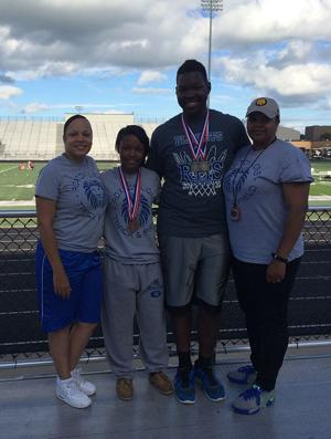 <p>Roxton regional qualifiers Keisha Green, second from left, and Dreikus Green stand alongside Roxton assistant coach Malissa Franklin, far left, and LaShunda Dangerfield, far right, at the Class 23-24 A meet on Wednesday.</p>