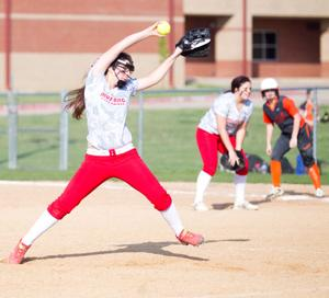 <p>Chisum pitcher Cheyanne Greener hurls a pitch towards home plate in the Lady Mustangs extra inning loss to DeKalb on Tuesday.</p>