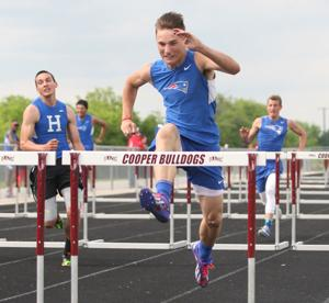 <p>Prairiland's Ashdon Langston clears a hurdle during the District 15-3A meet last week in Cooper. Langston won the 110-meter and 300 hurdles on Wednesday at the District 15/16 Area Meet in New Boston.</p>