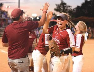 <p><strong>Handley's Emelie Brown (right, with glove) high fives assistant coach Chris Glass after Handley's 8-7 win over Northside in the third game of the state tournament Wednesday. Brown hit a three-run home run in the bottom of the sixth inning to give Handley the lead in that game.</strong></p>