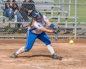 <p>HANNAH CHROMEY swings at a pitch Friday in a win over Kalama.</p>