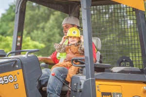 Children test out big machines at Dozer Day
