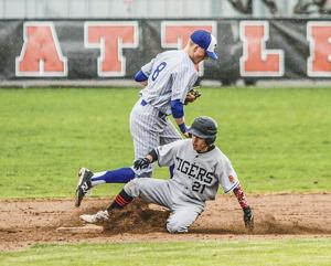 """<p><span id=""""docs-internal-guid-90134510-4e10-70f8-cfb6-bfd6d52b1872""""><span>BATTLE GROUND'S Colin Rubino (21) slides into second base during the Tigers' game with Mountain View Friday at Battle Ground High School. Rubino, a senior second baseman, is one of Battle Ground's three senior co-captains.</span></span></p>"""