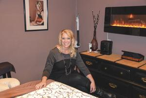 """<p>KRISTIN TAYLOR, OWNER of Bodywork Devine day spa in Ridgefield, sits in her private massage space. Taylor recently expanded her spa and now offers a full range of massage and beauty services, including spa pedicures, waxing and skincare services. For more information or to make an online appointment, visit<a href=""""http://www.bodyworkdevine.com"""">www.bodyworkdevine.com</a>.</p>"""