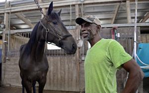 Photos: Veteran harness racing trainer prepares for state fair races
