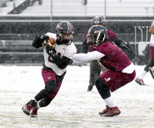 Salukis endure additional challenge with snow-covered field