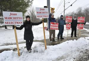 <p>Campaigning Tuesday outside of North Attleboro High School -- where seven of the town's nine precincts vote -- during the preliminary election to narrow the field by one in each of the selectmen's and school committee races are, from left: Selectwoman Joan Marchitto; Carl Nelson, who is running for Republican State Committeeman in the March 1 presidential primary; Mike Lennox, a selectmen's candidate; and Lennox's friend Tom Rammel.</p>