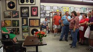 <p>Actress Betty Lynn is wheeled into a room of adoring fans at the Andy Griffith Museum in Mount Airy, N.C., on Friday, July 17, 2015. Lynn, who played Thelma Lou on the Andy Griffith Show, moved to Griffith's hometown in the foothills of the Blue Ridge in 2007 after her Hollywood home was broken into one too many times. (AP Photo/Emily Masters)</p>