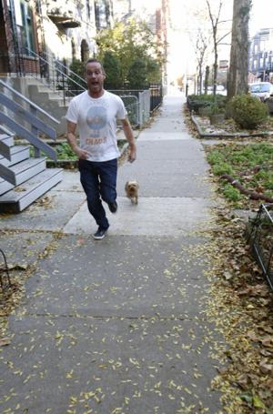 "<p>Dr. Rob Garofalo runs with his dog, Fred, in Chicago. Garofalo, who is head of the adolescent medicine division at Lurie Children's Hospital of Chicago, tested positive for the AIDS virus in 2010. He has since co-founded the ""When Dogs Heal"" photo project, which features HIV-positive people and their dogs. (AP Photo/Martha Irvine)</p>"