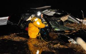Driver pulled from river