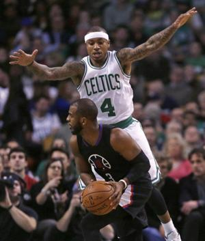 <p>Boston Celtics guard Isaiah Thomas (4) defends Los Angeles Clippers guard Chris Paul (3) during the first quarter of an NBA basketball game in Boston, Wednesday, Feb. 10, 2016. (AP Photo/Charles Krupa)</p>