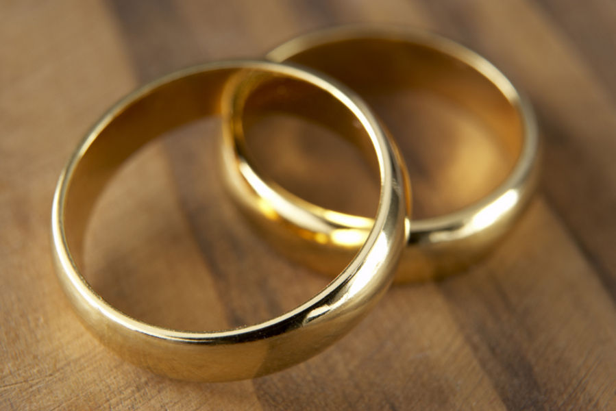 two wedding rings resting together - Old Wedding Rings