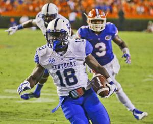 Kentucky suspends 4 players over air gun shots