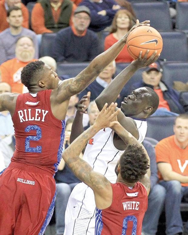 PULLING AWAY: No. 9 Virginia goes on late first-half run, downs South Carolina State, 75-55