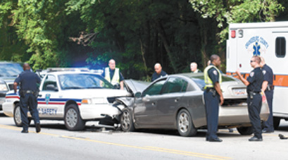 A city police officer is in stable condition after his vehicle was struck ...