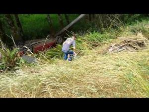 Tow drivers check out crashed vehicle