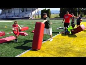 Youth Football camp keeps kids busy [video]