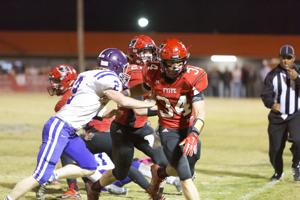 <p>Cyle Collins leads the way for Tyler Ashley against Ranburne last week in the quarterfinals.</p>