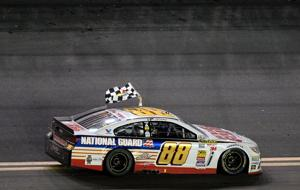 <p>DAYTONA BEACH, FL - FEBRUARY 23: Dale Earnhardt Jr. celebrates with the checkered flag after winning the NASCAR Sprint Cup Series Daytona 500 at Daytona International Speedway on February 23, 2014. (Photo by Jared C. Tilton/Getty Images)</p>