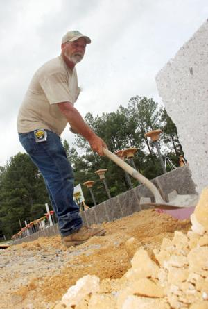 <p>Tony Womack, with Sam Construction, works on the foundation of a new Wound Care Center at DeKalb Regional Medical Center.</p>