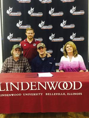 <p>Nick Overstreet signing his scholarship with his parents, James and Linda, and Lindenwood wrestling coach Angelo Crinzi.</p>