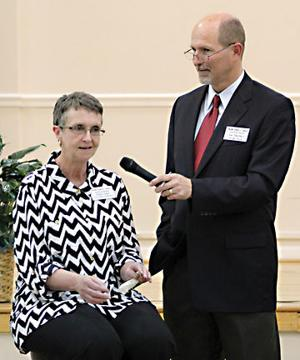 <p>Debbie Lanier (seated) introduced herself during the town hall meeting Tuesday night, March 31, 2015. Rainsville Chamber of Commerce Director Tim Eberhart (right)moderated the meeting.</p>