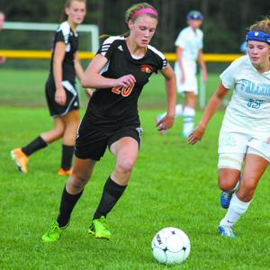 <p>Mountain Ridge's Niven Hegeman (20) works the ball downfield during a game against Frankfort last season. Hegeman was voted the Player of the Year.</p>
