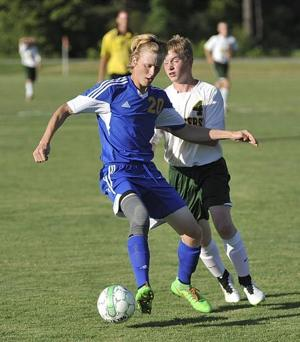 <p>Caldwell's Landon Holt (left) moves with the ball against a University Heights player during action Tuesday in Hopkinsville.</p>
