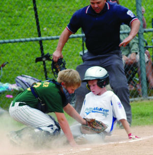 <p>Umpire Chris Waterman calls Potter/McKean base runner safe at home in the fourth inning of the Potter/McKean Blue game at home against RTL to advance to the loser bracket final with Sayre on July 8.</p><div> </div>