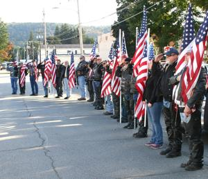 <p>Patriot Guard Riders who participated in the escort procession to bring 1st Lt. William Turner home to Potter County salute in honor of the Korean War veteran as his flag-draped casket is carried into the Fickinger Funeral Home in Coudersport Thursday afternoon. </p><div> </div>