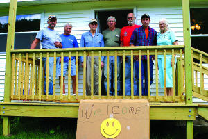 <p>Volunteers from Potter County Habitat for Humanity and the community were putting finishing touches last Thursday on the new house built to replace the one Norma Cobb Nichols lost in a Christmas Eve blaze. Many others spent time working on the house throughout the months, but the ones available to join Nichols (far right) on her front porch were (L - R) Fred Ayers, Dick Myers, Charles Nelson, Ivan Lehman, Klutch Kowski and Jimmy Harvey. </p><div> </div>