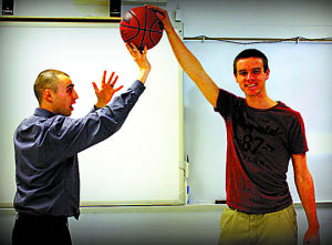 <p>Science teacher Ben Heyler getting stuffed by senior class member Bob Williams.</p><div> </div>