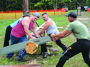 <p>During a one-man crosscut saw competition, it took three men to hold the log so one could swiftly cut through it.</p><div> </div>