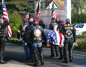 <p>Members of the Patriot Guard Riders carry the flag-draped coffin of 1st Lt. William Turner into the Fickinger Funeral Home this afternoon, Sept. 18, in Coudersport, where services for the Korean War veteran will be held tonight and tomorrow for family members and friends. A public memorial is planned for Saturday, Sept. 20, at the Park United Methodist Church, 15 East Third Street in Coudersport, beginning with a visitation at 10 a.m. and funeral service at 11 a.m. Air Force Brig. Gen. Frank Sullivan, a Galeton native, will deliver the memorial address. Turner and 51 other servicemen lost their lives when the Air Force cargo plane in which they were flying crashed into a mountainside in Alaska on a flight from Tacoma, Wash., to Elmendorf Air Force Base on November 22, 1952. </p><div> </div>