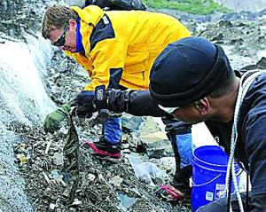 <p>The recovery team digs into the Alaskan glacial formation.</p><div> </div>