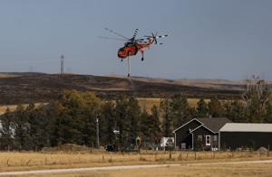 Photos: Fight against the Cole Creek Fire continues Monday