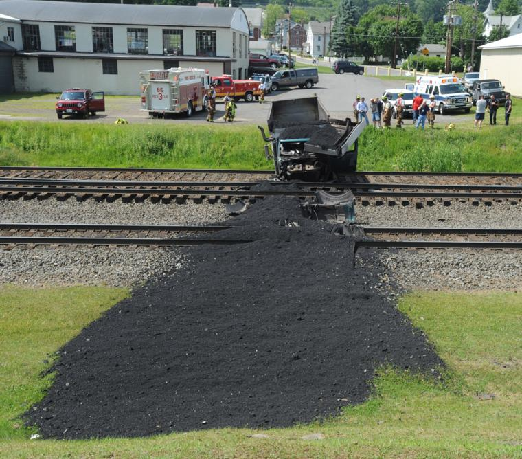 Coal truck crash closes train tracks in summerhill driver injured