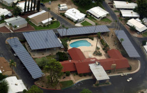 Big solar array gives mobile-home park power, shade
