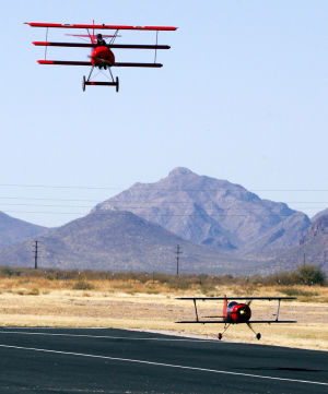 Model 'warbirds' flash over Marana