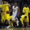 NCAA TOURNAMENT: Duke holds off Michigan, now meets UA