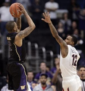 Men's Pac-10 tournament: Washington 77, Arizona 75, OT: Trouble closing it out