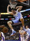 NBA Nuggets dunk Suns to extend win streak