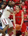 Arizona 73, Ball State 63 Parrom an inspiration in first game back