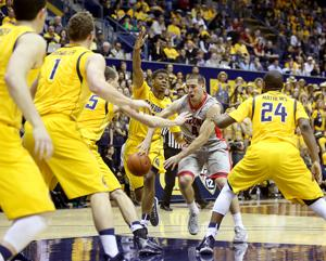 Photos: No. 7 Arizona 73, California 50