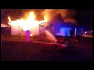 Watch: Tucson Fire Department battles arson at house